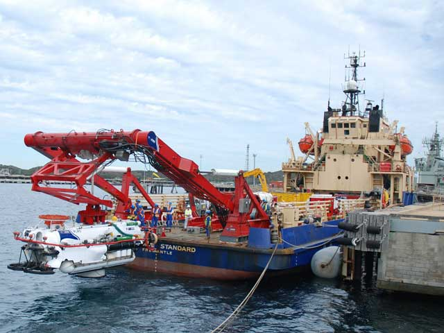 The LR5 Submarine Rescue Vessel is lowered in to the water via the launch and recovery A-frame on the rear deck of Trials and Safety Vessel Seahorse Standard.