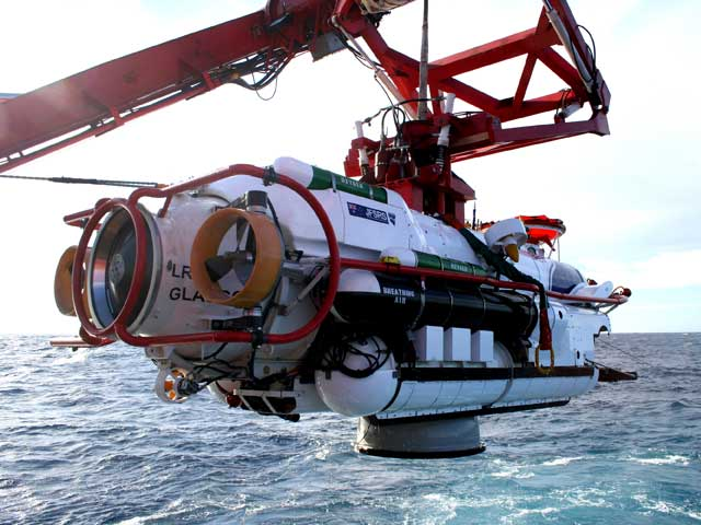 LR5 rescue vehicle is recovered to the Australian rescue ship after transferring submariners from the RAN submarine HMAS Waller while it sat on the seabed.