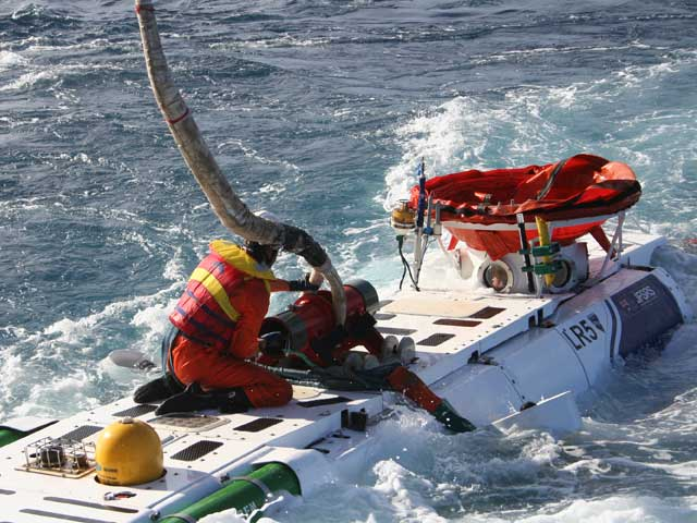 Lines are attached to the James Fisher Defence LR5 rescue vehicle by a Franmarine underwater services swimmer in preparation for recovering the rescue vehicle onboard the Defence Maritime Services rescue ship, Seahorse Standard.