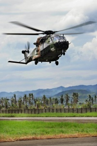 HMAS Tobruk's embarked MRH-90 helicopter arrives at Ormoc Airport, Philippines, during Operation PHILIPPINES ASSIST.