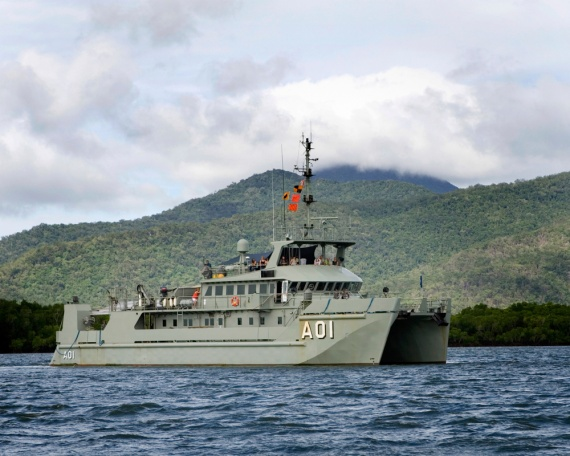 HMAS Paluma returns to HMAS Cairns after a family day out on the water.