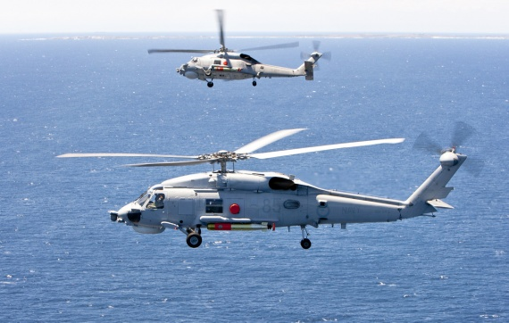 Sikorsky S-70B-2 Seahawk helicopters break formation whilst conducting a weapons firing serial off the coast of Western Australia.