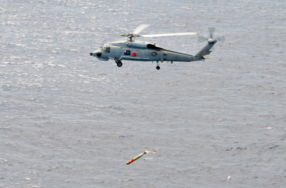 A Sikorsky S70B-2 Seahawk helicopter conducts a weapons firing serial, firing a Mk 46 torpedo, off the coast of Western Australia.