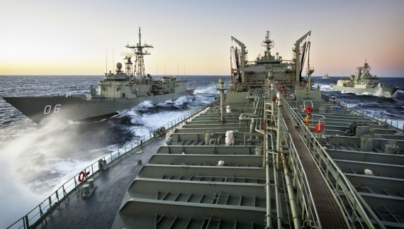 HMA Ships Newcastle and Warramunga pull up to station's 1 and 2 for a replenishment at sea from HMAS Sirius, HMNZS Te Kaha takes up lifeguard station to the rear of the evolution.
