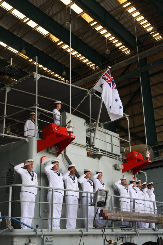 Ships Company of HMAS Wewak salute during the Decommissioning Ceremony at HMAS Cairns Naval Base, North Queensland.