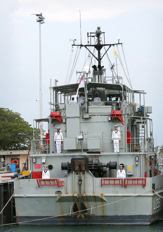 Crew members onboard HMAS Balikpapan for the last time during her decommissioning ceremony