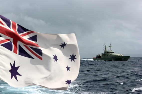 HMAS Pirie departing Smith Point refuelling depot at Christmas Island, as seen from the stern of HMAS Larrakia, while on Operation RESOLUTE duties.