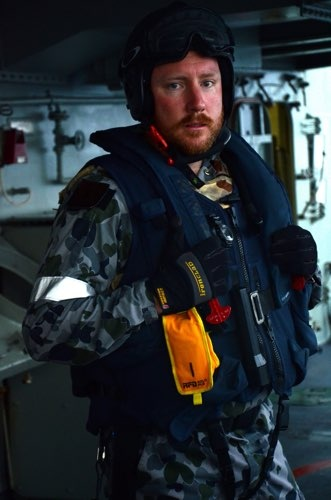 Boarding officer Lieutenant D. Osborne prepares to lead his team to intercept a dhow in the Somali Basin. Piracy, drug and illegal arms smuggling in the Indo Pacific poses an ongoing threat to regional maritime security.