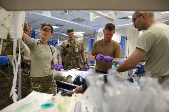 Royal Australian Navy nursing officer Lieutenant Megan Hoare works with other Australian and US medical personnel to treat a role-playing casualty during an exercise at Nato's Role 2 hospital at Kabul Airport.