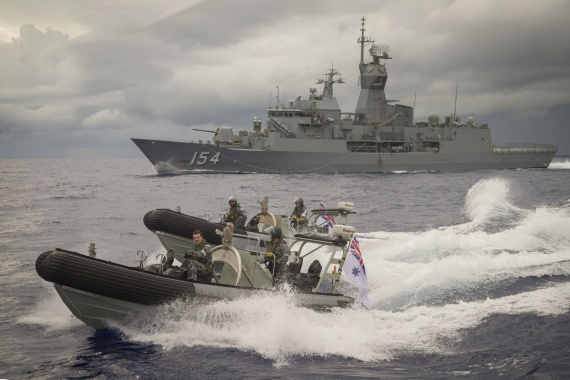 HMAS Parramatta's seaboats speed away from the ship in the waters of Yap, Micronesia.