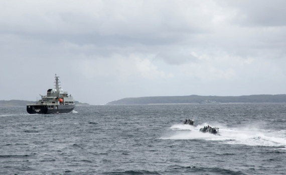 HMAS Toowoomba's boarding party approach the training ship MV Sycamore during a boarding drill as part of Exercise OCEAN EXPLORER 2018.