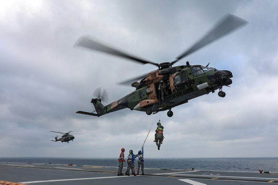 Aviation Support trainees practice winching operations with HMAS Adelaide's embarked MRH-90 helicopter, Poseidon 29.