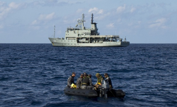 Navy Clearance Divers travel towards HMAS Leeuwin in a Rigid-Hulled Inflatable Boat while crossing the Bay of Bengal on the way to Sri Lanka.