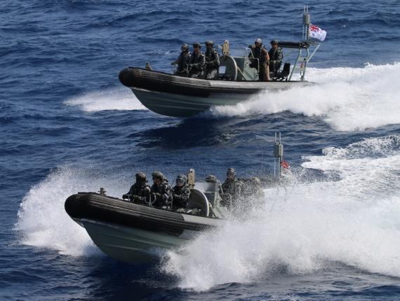 HMAS Ballarat's boarding party close on a suspicious dhow for a boarding.