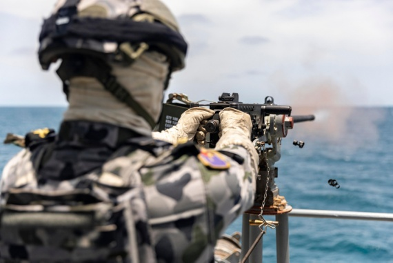Leading Seaman Boatswains Mate Andrew Jennings fires a 12.7mm Browning machine gun while on HMAS Parramatta.