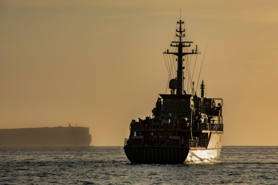 Minehunter Coastal, HMAS Yarra at anchor in the early morning light in Jervis Bay.
