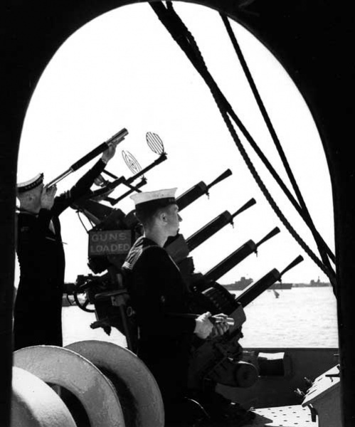 Signalmen 'Slim' Roper and Joe Harris keeping a visual lookout in Alexandria Harbour, Egypt, 1941