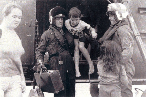 HT725 Squadron personnel assist evacuees out of a Wessex helicopter during the Nowra floods in 1974.