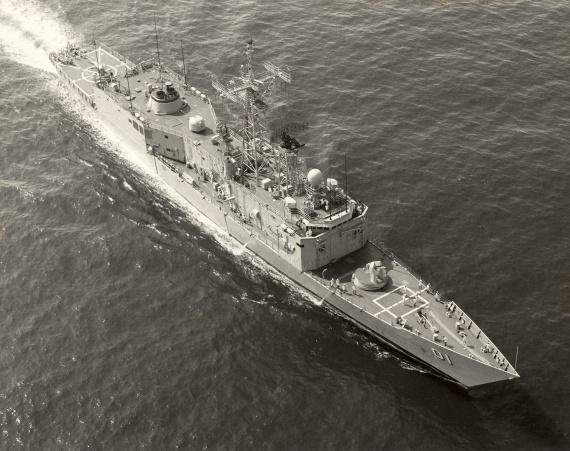 An aerial view of HMAS Adelaide taken prior to flight deck modernisation