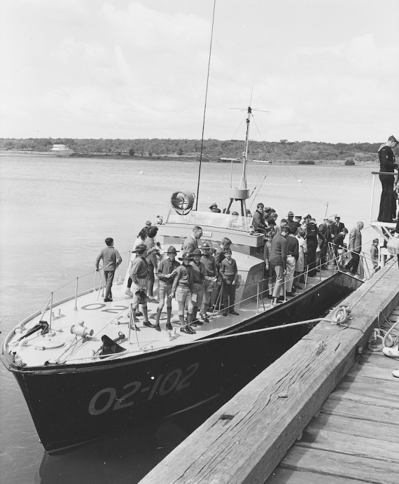 Air Spray alongside HMAS Cerberus, Westernport, Victoria disembarking boy scouts after a day at sea. Note that in this image she is wearing her RAAF pennant number 02-102