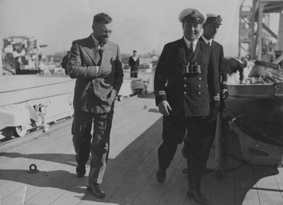 Pioneer aviator and yachtsman Francis Chichester confers with Lieutenant GL Cant, RAN during a visit to Albatross following his history making first solo flight across the Tasman Sea from East to West (New Zealand-Australia), circa 1931.