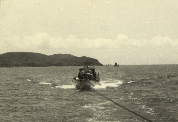 ML 1323 under tow to Hong Kong by HMS Concord