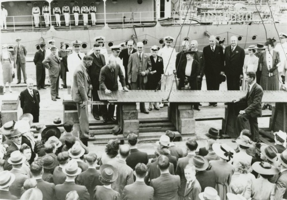 Laying the keel of the first Australian Corvette, HMAS Bathurst, at Cockatoo Island Dockyard.