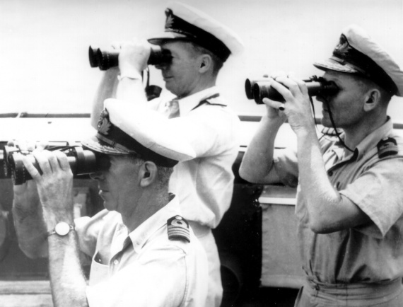 L-R: Captain EFV Dechaineux, DSC, RAN, Commodore JA Collins, CB, RAN and Commander JF Rayment, DSC, RAN on the compass platform of HMAS Australia during naval operations in the Philippines. Dechaineux and Rayment were killed on 21 October 1944 following an attack by a Japanese suicide aircraft.