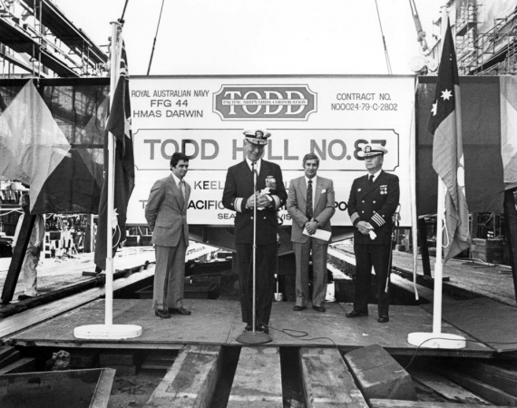 Darwin's keel was laid on 3 July 1981 at Todd Pacific Shipyards Corporation Seattle Division, Washington, USA. Pictured are (L-R): John T Gilbride, Jr; RADM Beecher, USN; The Hon. Nick Dondas; and CAPT F William Meyer, USN.