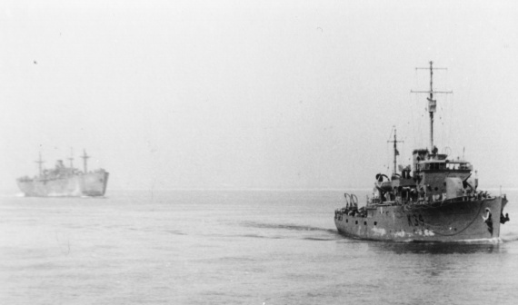 HMAS Ararat escorting a merchant ship