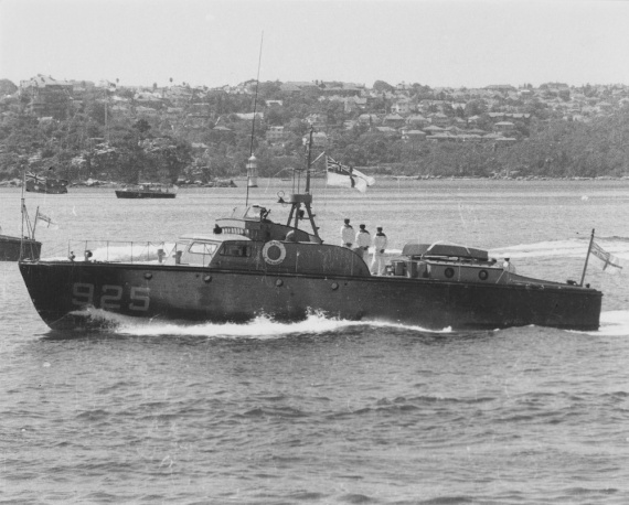 HMAS Air Mercy underway and dressed with masthead ensign in Sydney Harbour, 1953.
