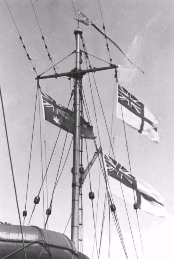 HMAS Bathurst flying her Australian National Flag and White Ensign.