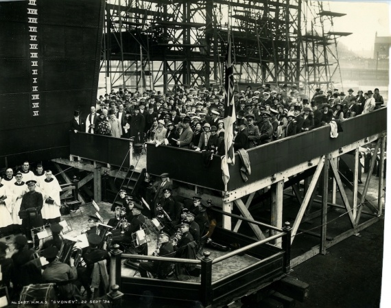 Mrs Ethel Bruce, the wife of Mr Stanley Bruce, MC, the Australian High Commissioner to Great Britain, offically names Sydney at her launching ceremony, 22 September 1934.