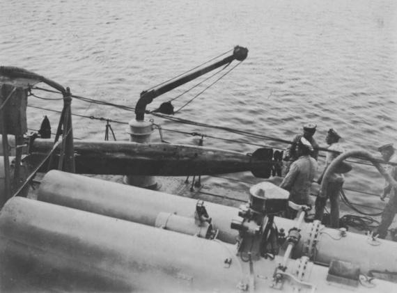 Loading HMAS Tasmania's 21-inch torpedos.