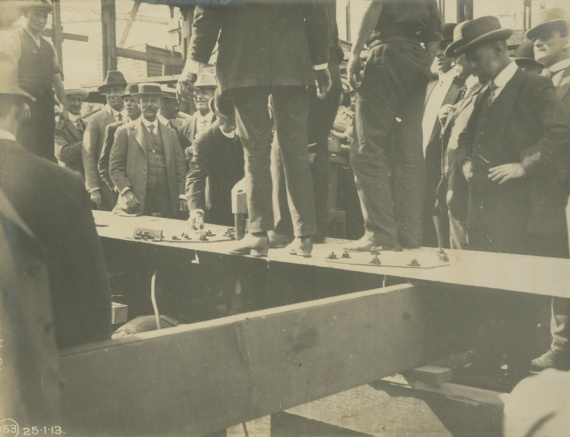 Mr Kidd laying the keel plate of HMAS Torrens