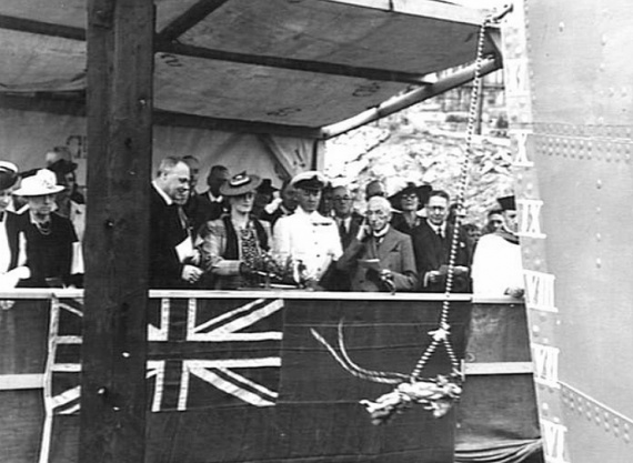 Mrs Bennett, wife of a Director of Mort's Dock and Engineering Co Ltd, names and launches HMAS Lithgow. (AWM 004395)