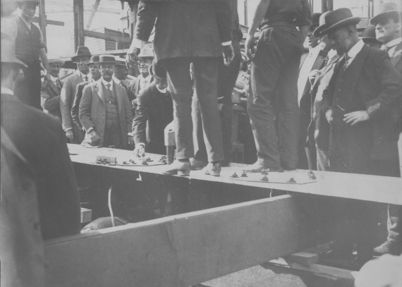 Mr Kidd laying the keel plate of HMAS Torrens.