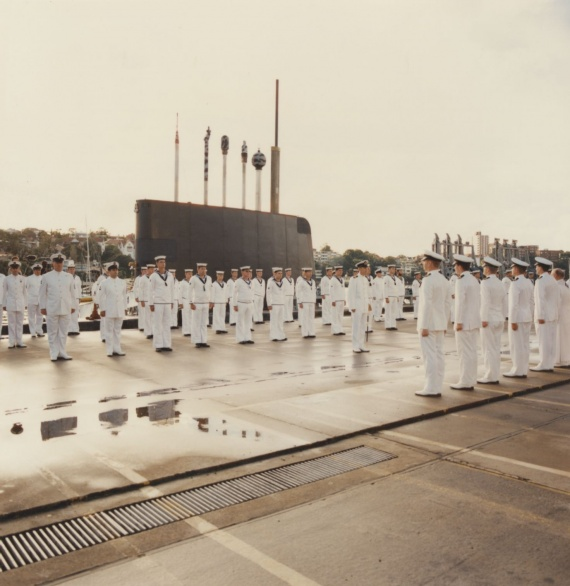 Ceremonial divisions at Platypus with one of the six Oberon class submarine visible in the background