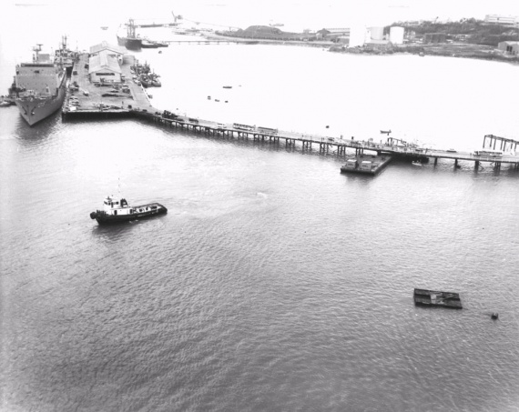 The pontoon and tug used to remove Arrow from the seabed under Stokes Hill Wharf and tow her to Frances Bay.