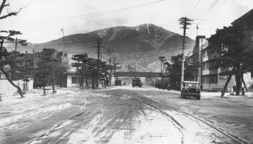 The main street of Kure, on a winter's day, showing the BCOF Headquarters on the right hand side.