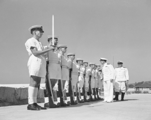 Commander Max Clark, DSC, RAN inspecting a guard at HMAS Commonwealth in late 1948.