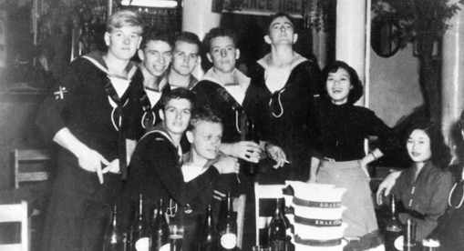 Australian sailors ashore in a Kure beer hall with Japanese hostesses.