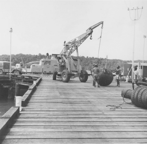 Tarangau's wharf was an integral part of the establishment's infrastructure and home to five of the Attack class patrol boats.HMAS Madang is visible in the background.