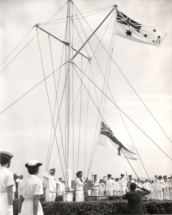 The Royal Navy White Ensign is lowered for the last time in a ceremony at HMAS Watson, 1 March 1967
