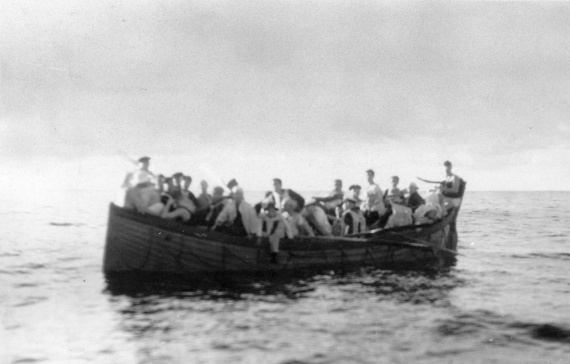 Crew of the German Supply Ship Coburg approaching HMAS Canberra after scuttling their own ship to prevent it from being captured.