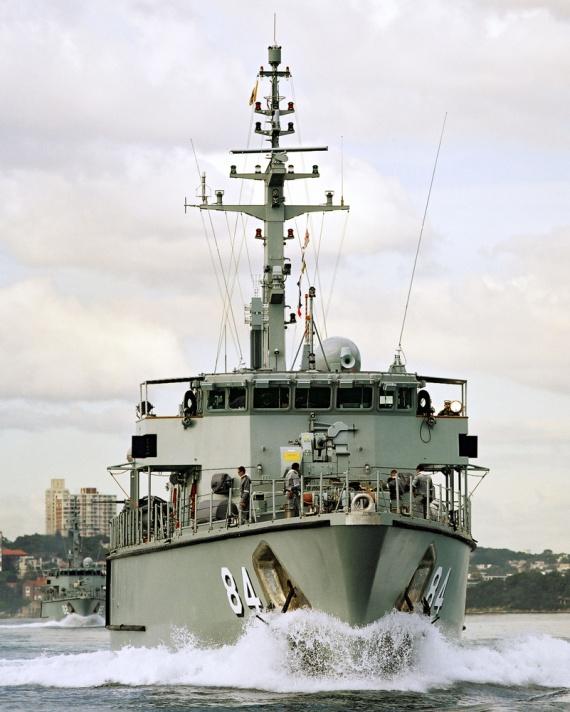HMAS Norman leads HMAS Huon out of Sydney Harbour.