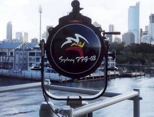 A ten-inch signlling lamp decorated with the Sydney Olympic logo aboard HMAS Sydney (Russ French).