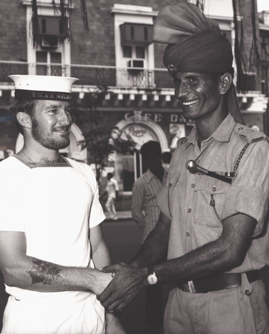 Leading Seaman Stores Naval Steve Page shakes hands with an Indian Navy Sailor c. September 1977.