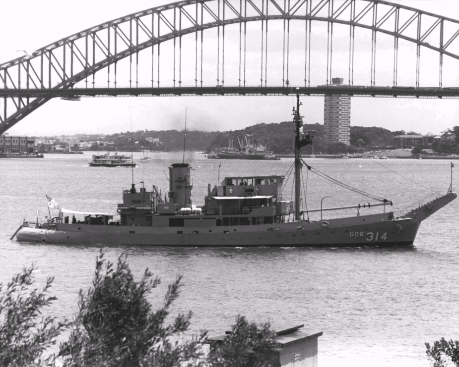 HMAS Kimbla leaving Sydney Harbour with a snail painted on her funnel.