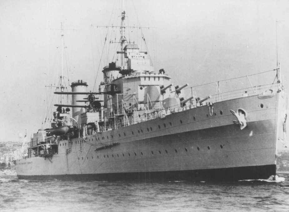 HMAS Hobart leaving harbour in her pre war paint scheme